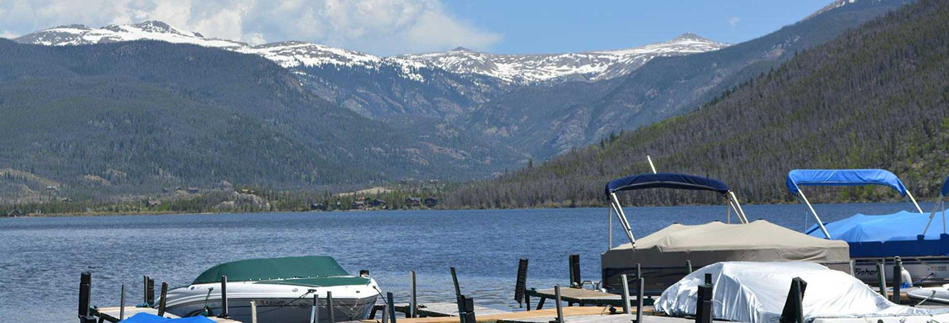 Motorboat dock being overlooked by Rocky Mountains.