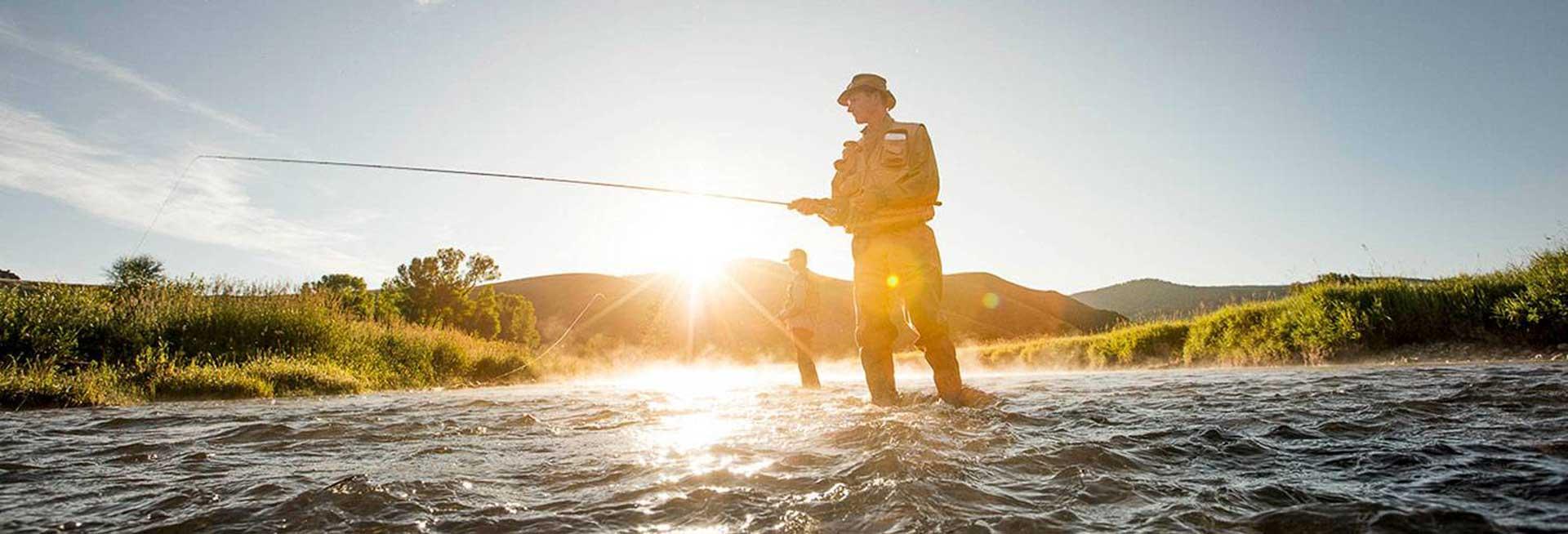 Men flyfishing on the river.