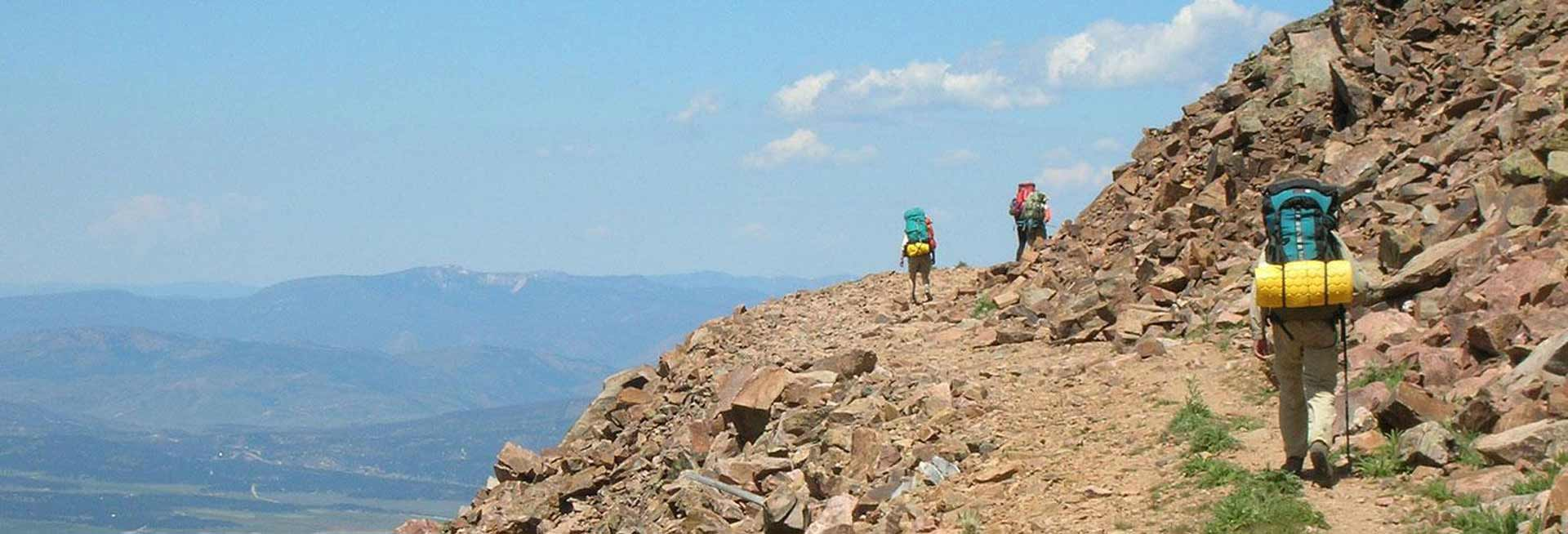 Hikers on a rocky trail.
