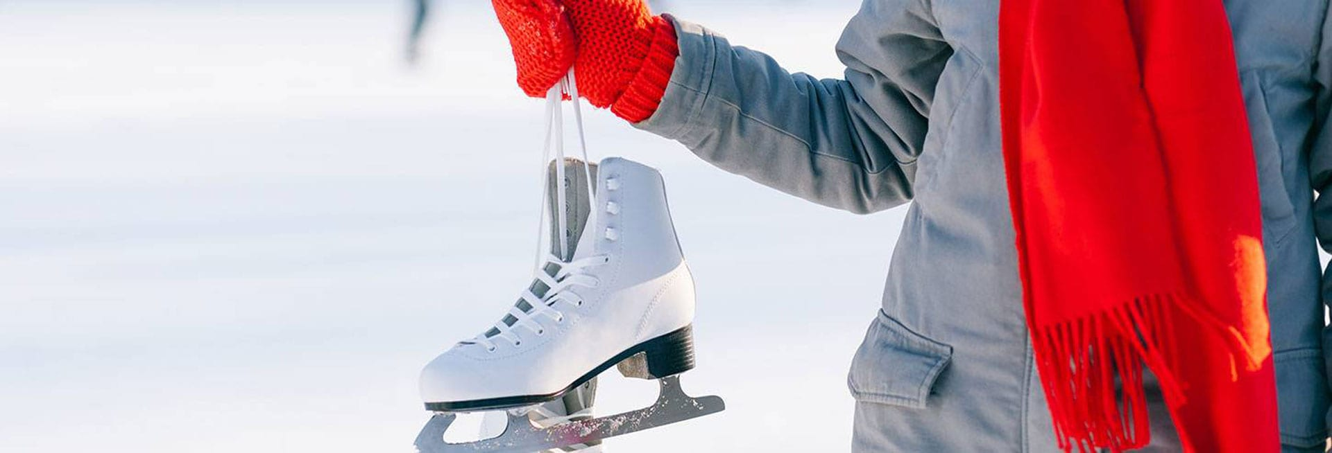 Person holding an ice skate.