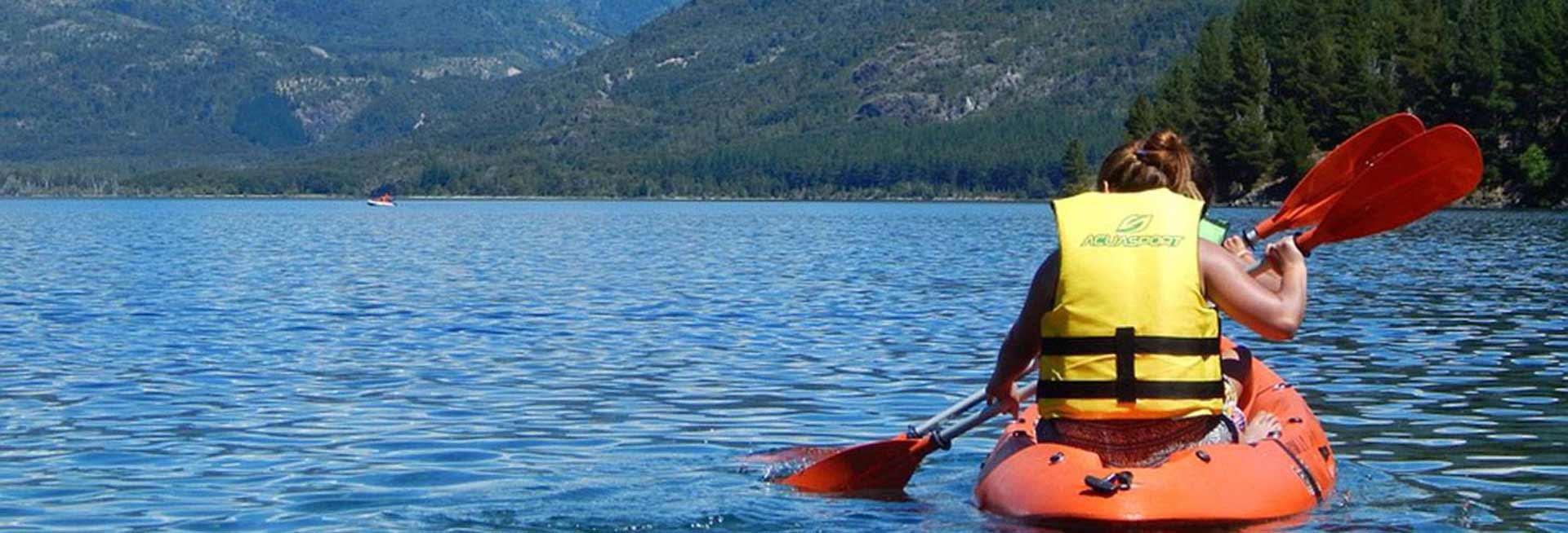 People kayaking on a large lake.
