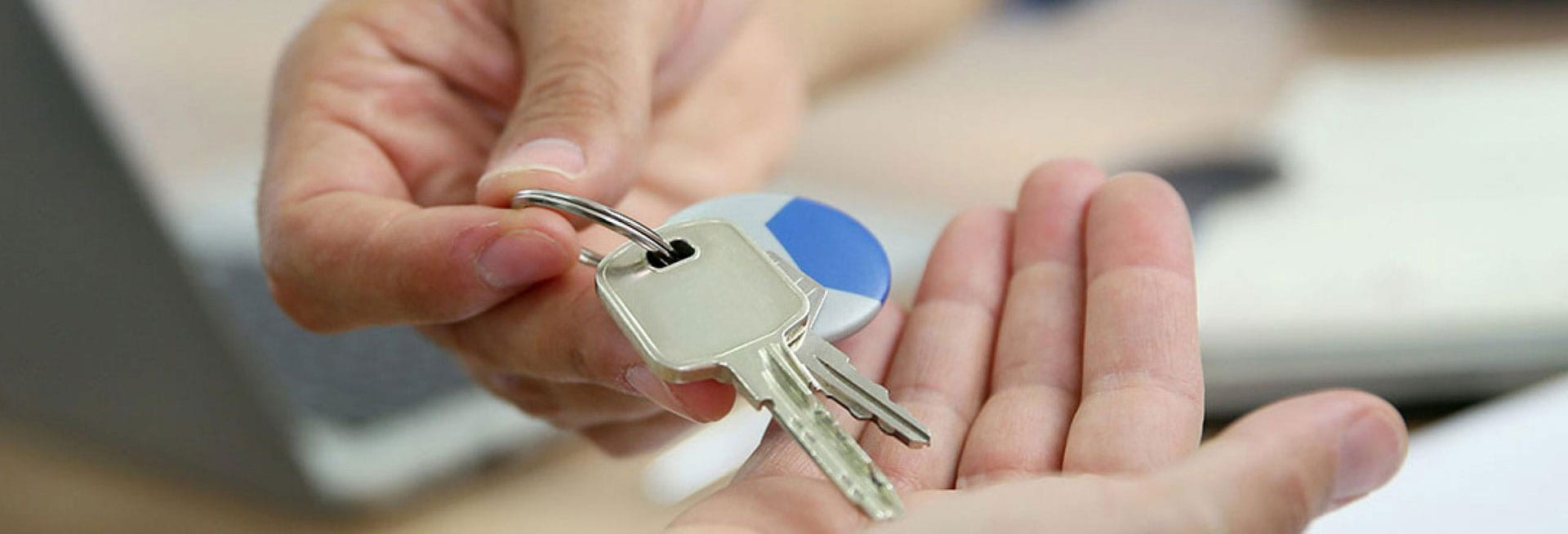 Person being handed car keys.