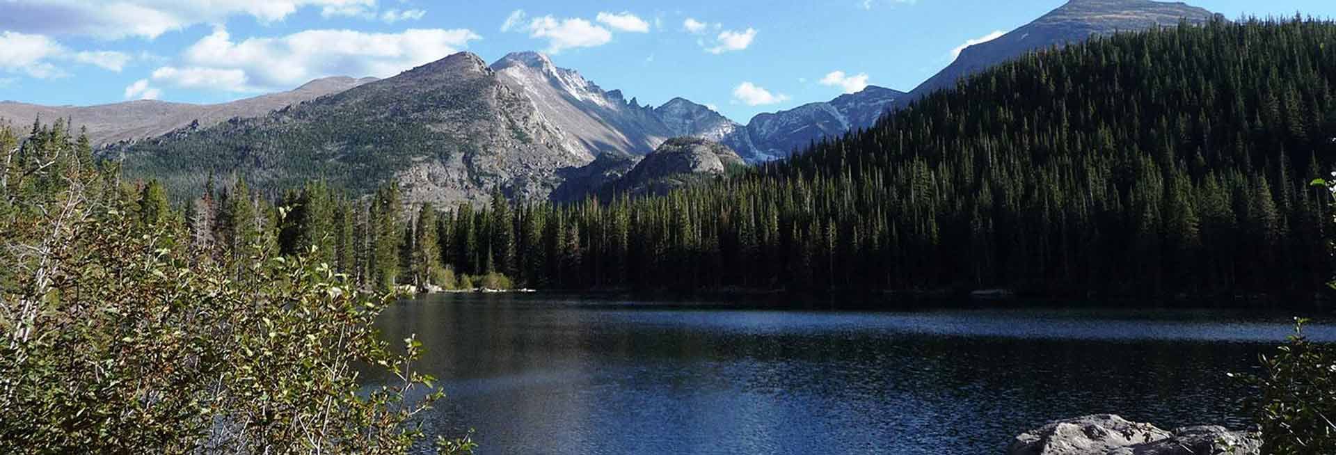 Rocky Mountains, forest and lake.