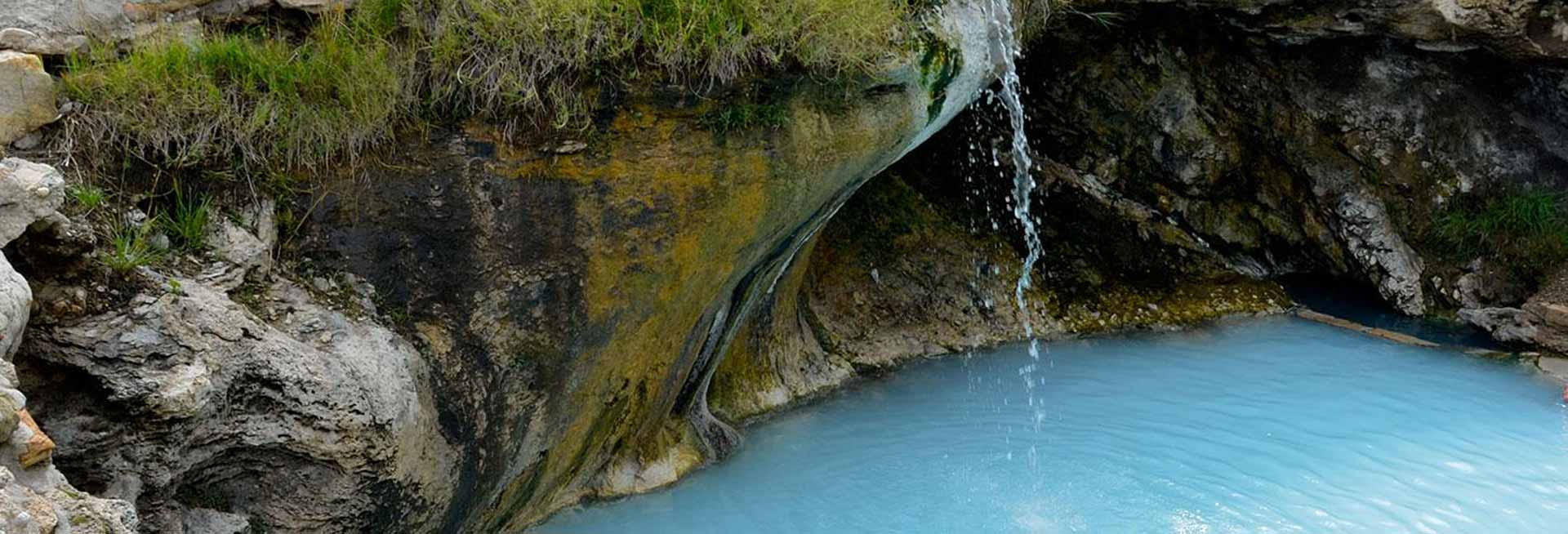 Waterfall into a natural pool.