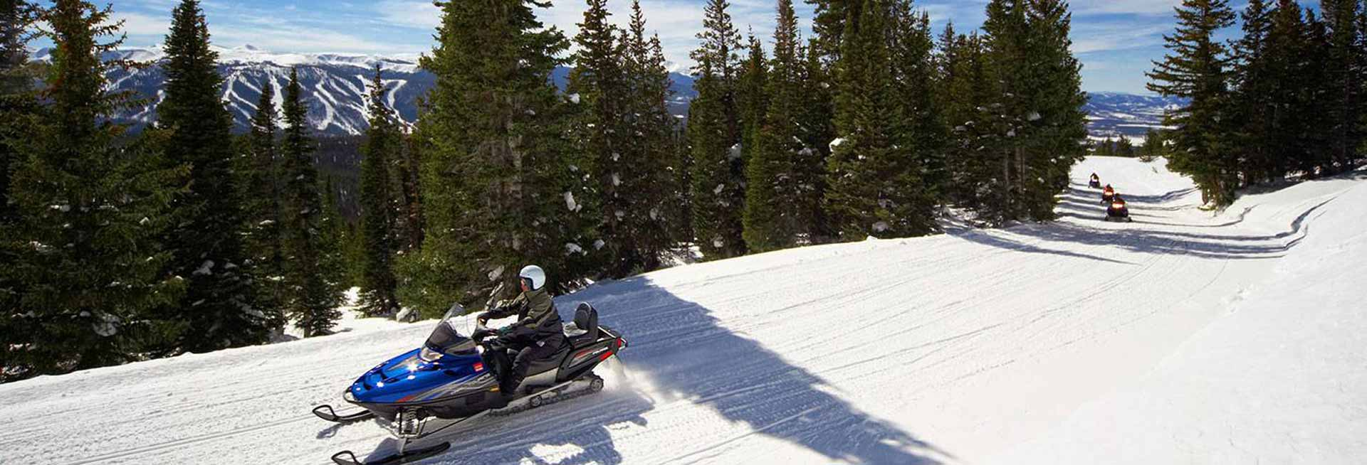 Snowmobiler on trail.